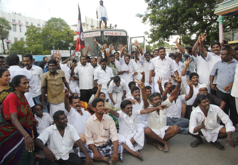 AIADMK cadres staging a road roko in Madurai following the conviction of Tamil Nadu's Chief Minister Jayalaithaa under corruption charges.