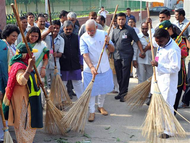 Image 1: Narendra Modi during a 'Clean India' campaign launch in Newd Delhi