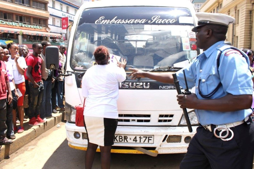 """SHAME ON YOU""! An angry protestor stops an Embassava Sacco bus. This is about 1: 05 PM."