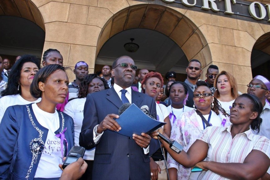 The Chief Justice of Kenya, Dr. Willy Mutunga (centre), receives the petition. He promises that justice to the victims shall be realised. This is about 2: 35 PM.