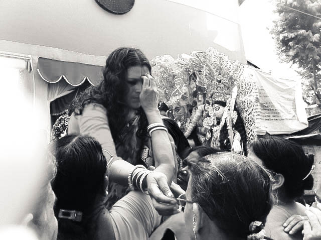 During sindurkhela, women smear each other's faces with vermillion – a red-coloured power typically used to mark the foreheads of ('respectable') married women; the ritual signifies Durga's impending farewell from earth and her natal family.