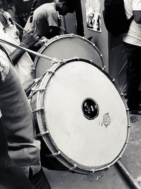 The reverberating beats of the dhak (drum) are an important part of Puja celebrations. The dhak is a huge drum that is played during Puja and is sometimes embellished with long white or multi-coloured feathers.