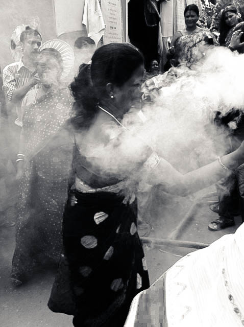 Women dance in front of Durga to the beats of the dhak.