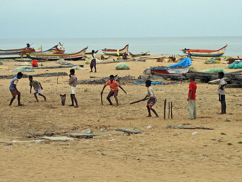 Urban poor kids playing cricket on the beach in Mahabalipuram near Chennai