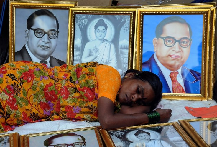 woman-sleeps-among-ambedkar-picture