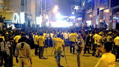 Policemen managing the crowd during the New Year celebrations in India's hi-tech city of Bangalore. Photo Courtesy AFP.